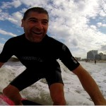 Close up of guy having fun while surfing