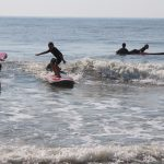 group of young surfers learning to surf