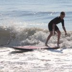 teen surfing by himself